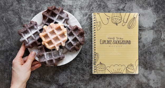 Top view of waffles on plate with notebook