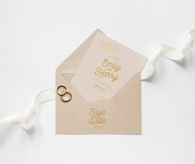 Top view of wedding card with envelope and rings