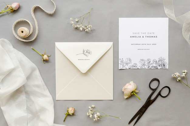 Top view of wedding card with envelope and scissors