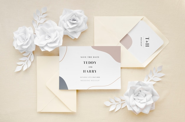 Top view of wedding card with envelopes and paper flowers