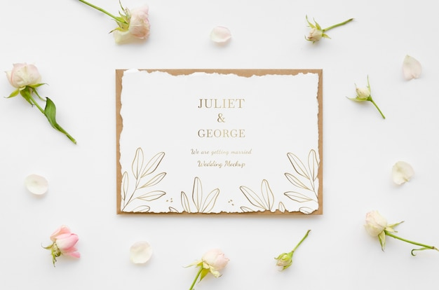 Top view of wedding card with flowers