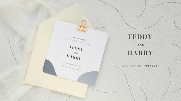 Top view of wedding card with paper clip and envelope