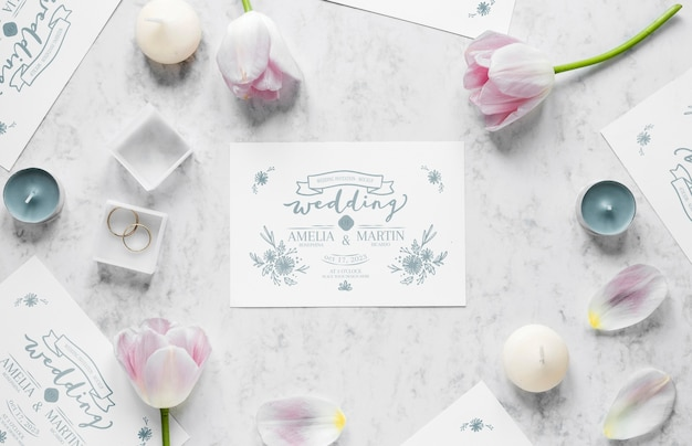 Top view of wedding card with rings and tulips