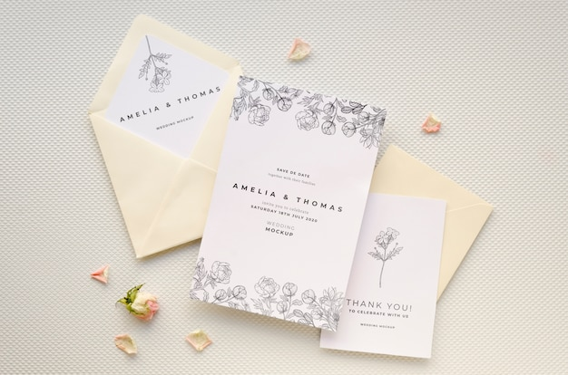 Top view of wedding card with rose and envelopes