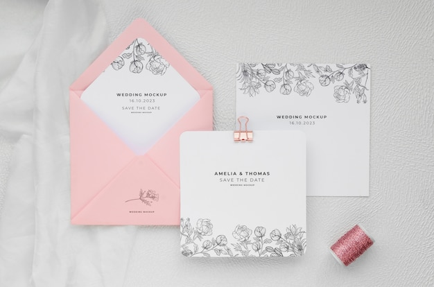 Top view of wedding cards with envelope and thread