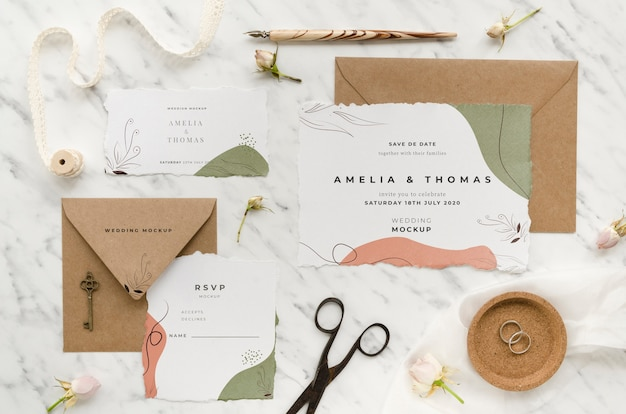 Top view of wedding cards with ribbon and scissors