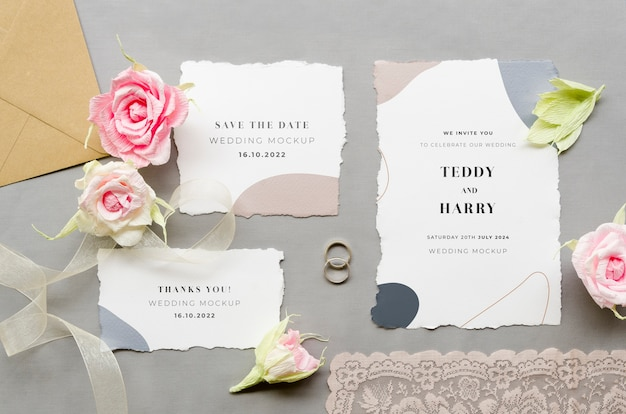 Top view of wedding cards with roses and rings