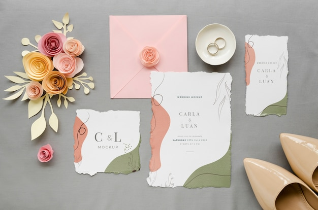 Top view of wedding cards with shores and roses