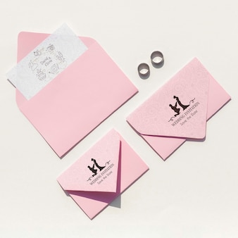 Top view wedding ideas with various envelope sizes
