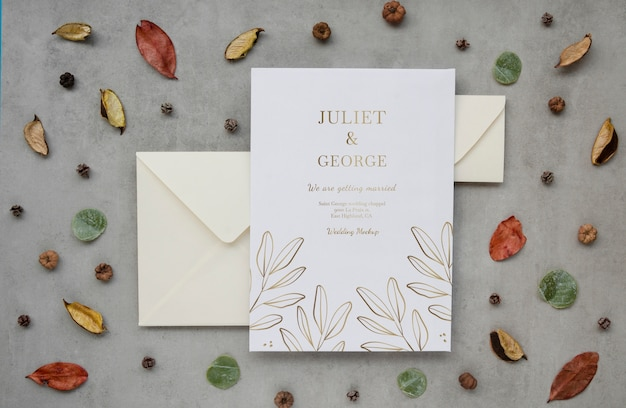 Top view of wedding with envelopes and leaves