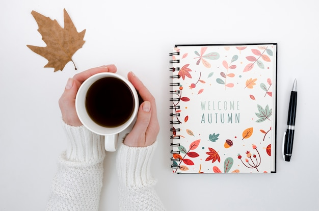 Top view welcome autumn on notebook