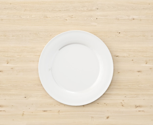 Vista dall'alto piatto bianco sul tavolo di legno