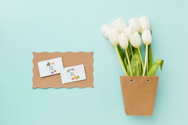 Top view of white tulips and cards
