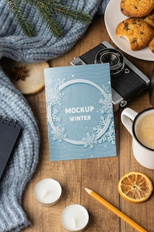 Top view winter hygge arrangement with card mock-up