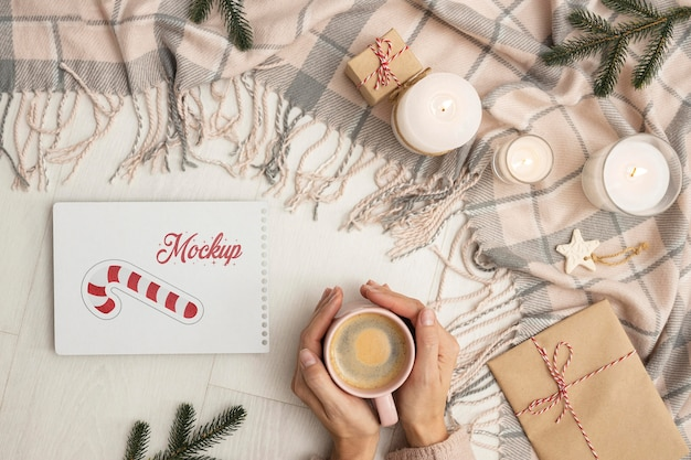 Top view winter hygge composition with card mock-up