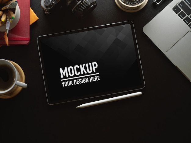 Top view of workspace with digital tablet mockup