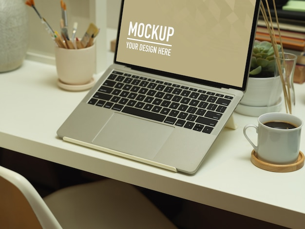 Top view of workspace with laptop mockup