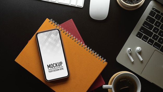 Top view of workspace with phone mockup
