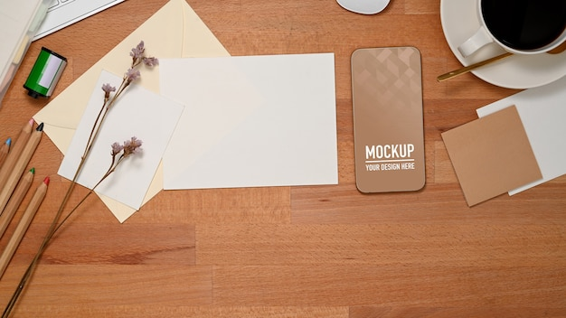 Top view of workspace with smartphone mockup