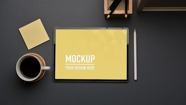 Top view of workspace with tablet mockup and stationery in home office