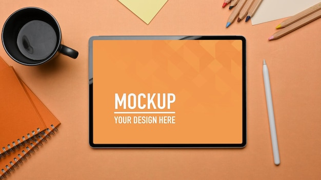 Top view of workspace with tablet mockup