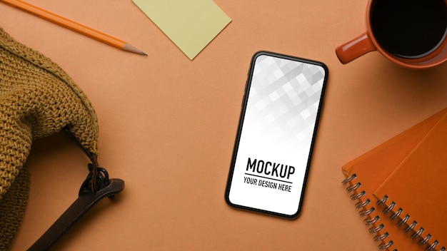Top view of worktable with smartphone mockup