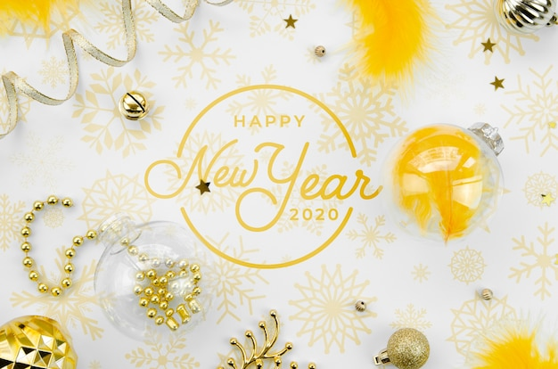 Top view yellow new year party accessories and happy new year lettering
