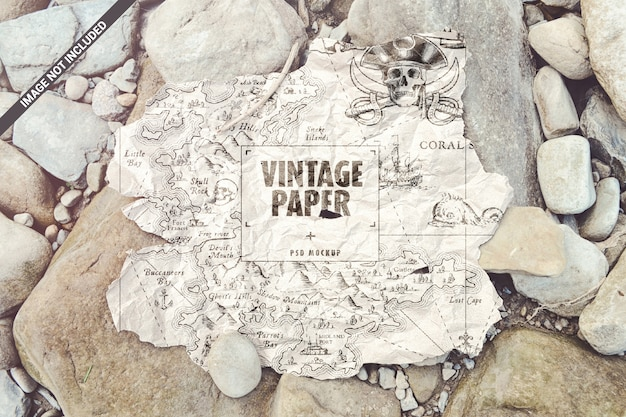 Torn old paper map on the stones mockup
