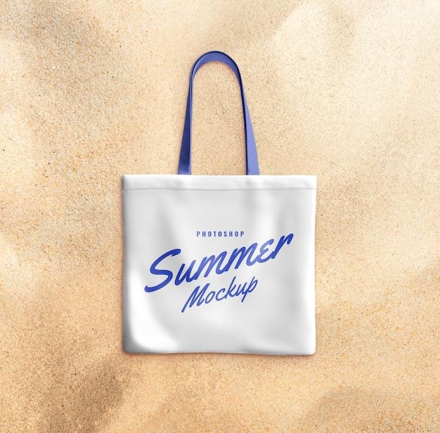 Tote bag on sand mockup realistic