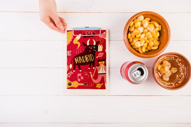 Traditional spanish food mockup with clipboard