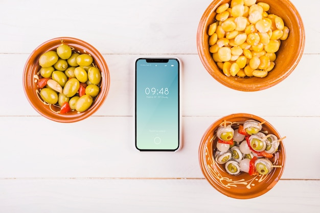 Traditional spanish food mockup with smartphone