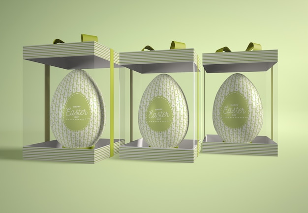 Transparent boxes with easter eggs on table