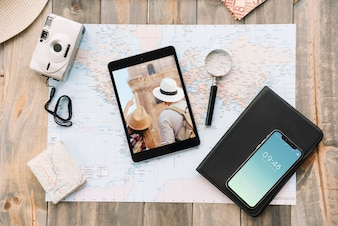 Travel concept with smartphone and tablet