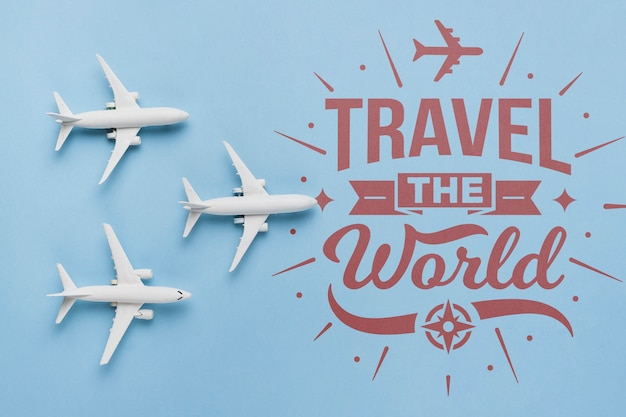 Travel the world, inspirational lettering quote with airplane toys