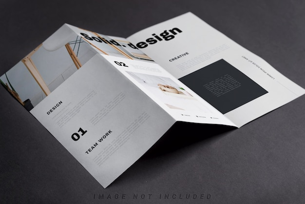 Trifold brochure on black table