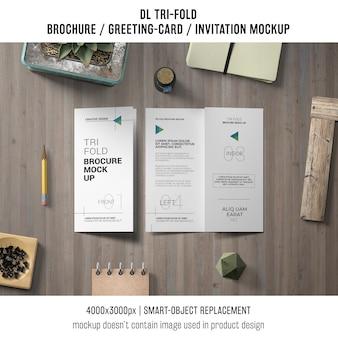 Trifold brochure or invitation mockup still life concept