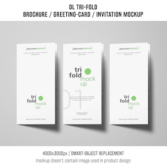 Trifold brochure or invitation mockups next to each other
