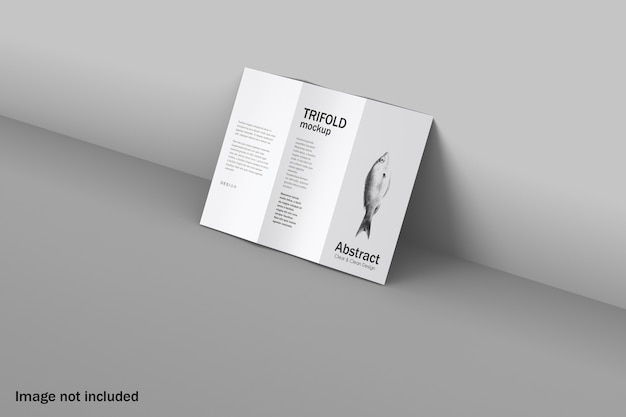 Trifold mockup leaning against at wall