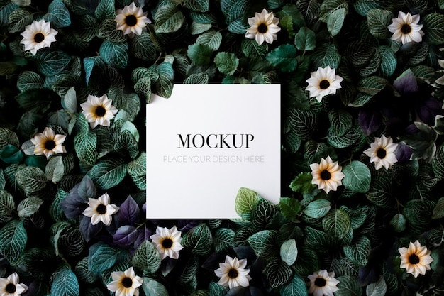 Tropical foliage background with daisies mockup