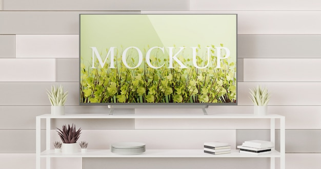 Tv mockup mounted on the tiles wall with white table