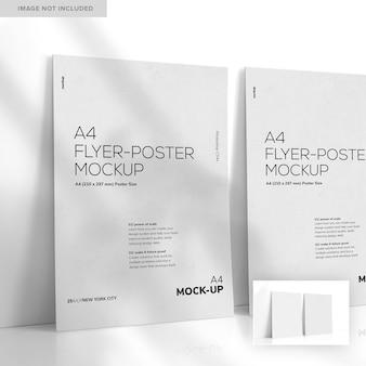Два листа формата а4, опираясь на стену, макет флаера-плаката