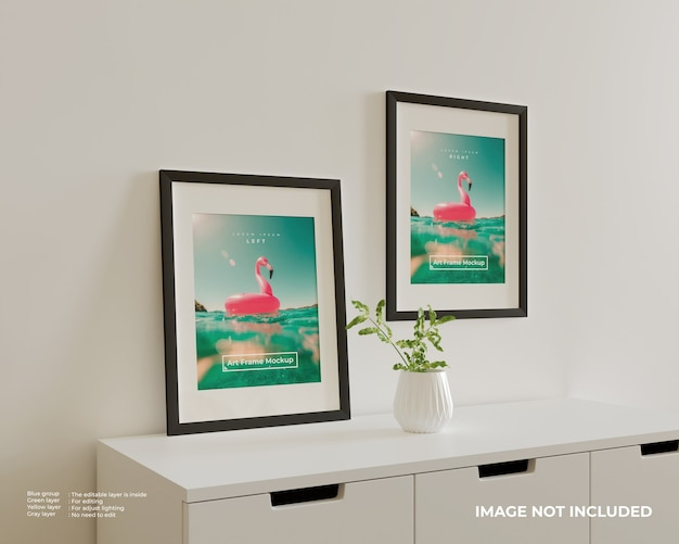 Two art frame poster mockup on top of the white cupboard