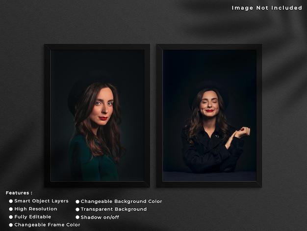 그림자가 있는 벽 배경에 매달려 있는 두 개의 검은색 세로 사진 프레임 모형.