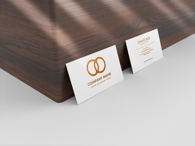 Two business card debossed orange shiny texture mockup
