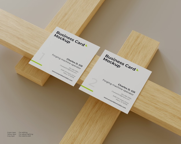 Two business cards mockup are on a pile of wood