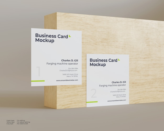 Two business cards mockup in front of the wood