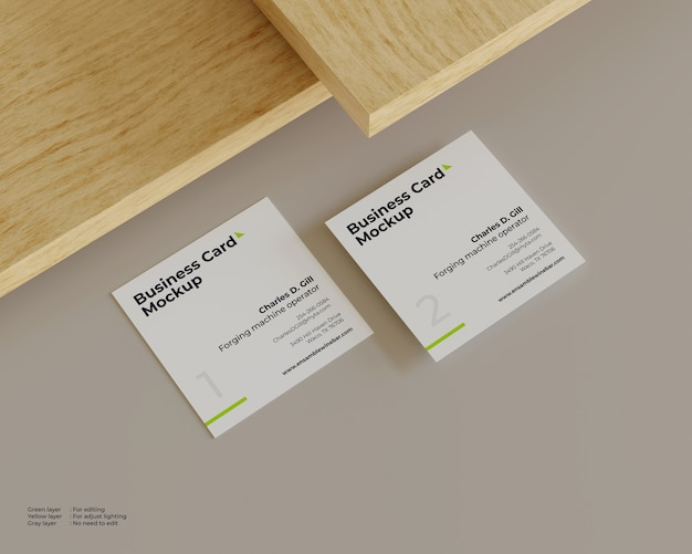 Two business cards mockup under the wood