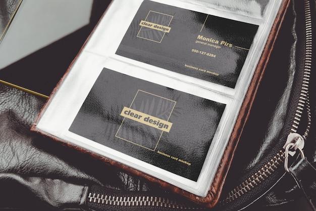 Two business cards in plastic holder scene mockup