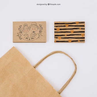 Two cardboard business cards and bag