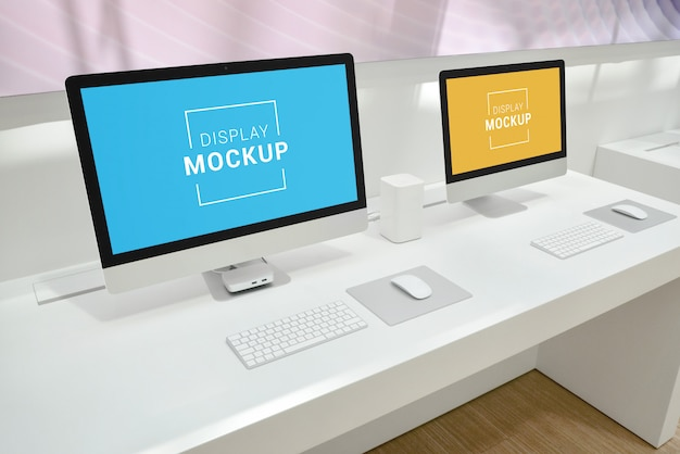 Two computer displays mockup on office desk